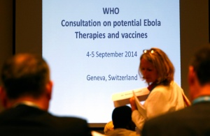 Participants arrive at the opening of a consultation of international experts on potential Ebola therapies and vaccines in Geneva